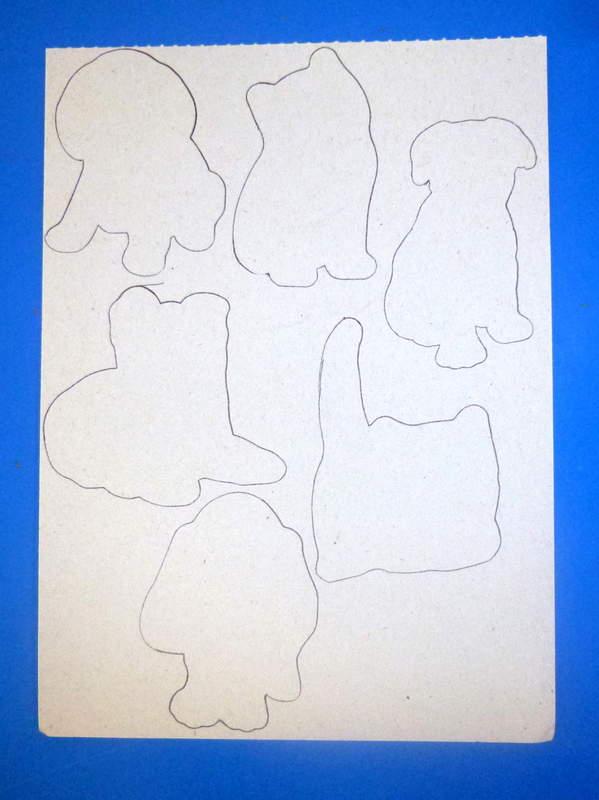Su di un cartoncino disegnate delle forme di animali.